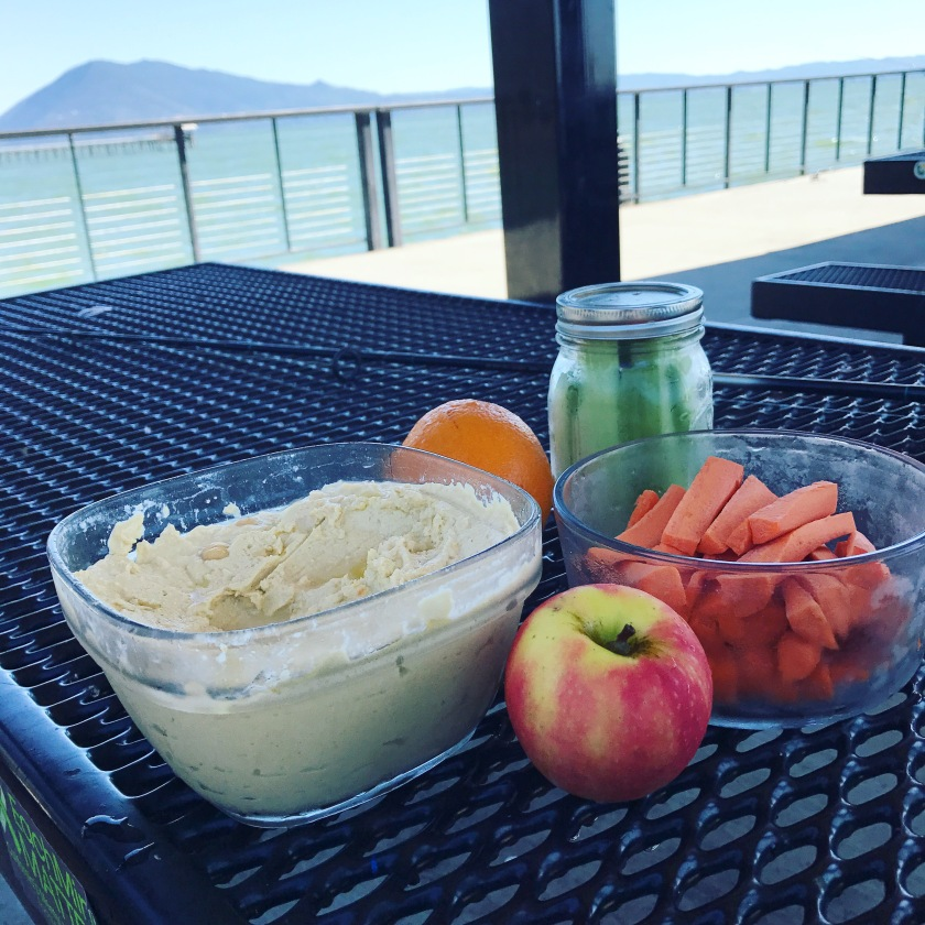 Zero Waste snack time: homemade hummus, carrot sticks, celery sticks, apples and oranges. 🍊